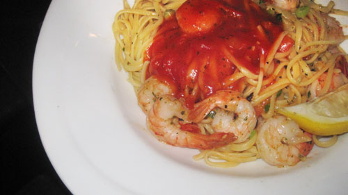 a plate of shrimp linguine with tomato sauce